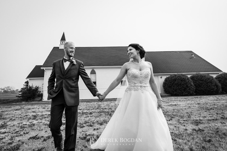 Newlyweds outside church portrait smiling Manitoba wedding Bel Acres Golf wedding