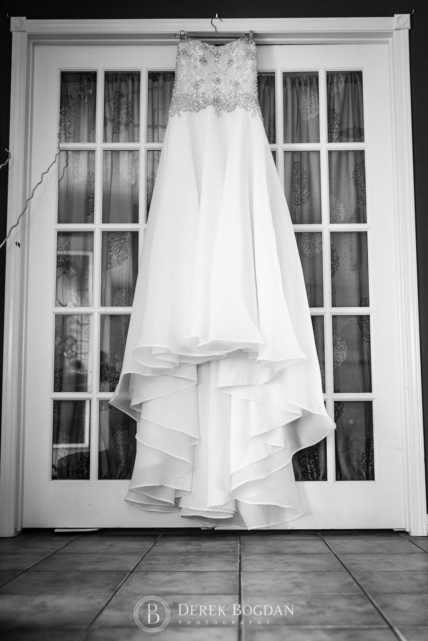 Bel Acres Golf wedding Manitoba bridal dress hanging on french doors
