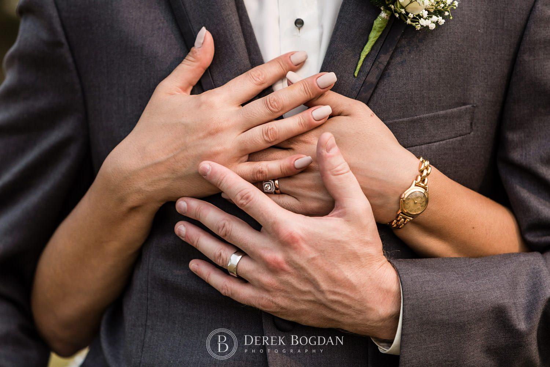 Newlyweds holding hands in love Manitoba wedding