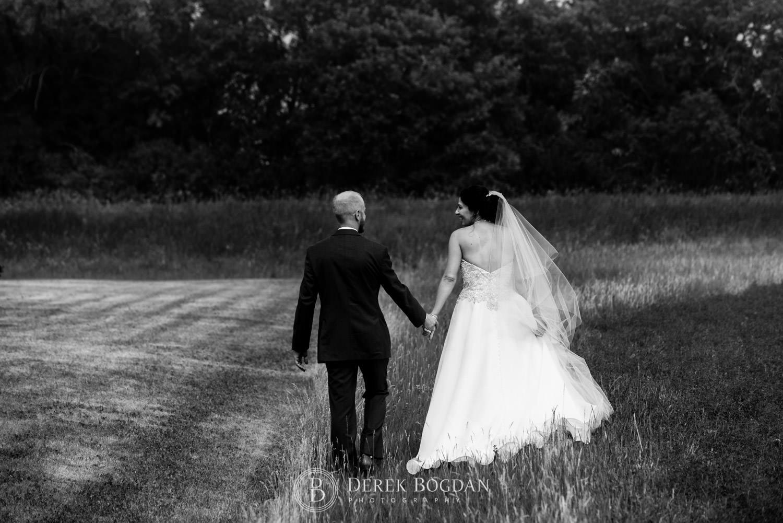 Hand in hand newlyweds portrait Bel Acres Golf wedding