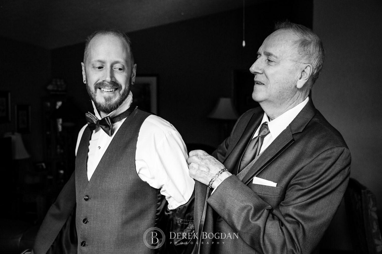 Bel Acres Golf wedding Manitoba groom getting ready dad putting on jacket