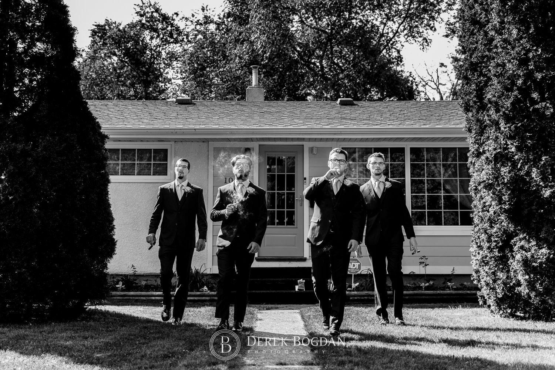 Groom and groomsmen walking with cigars