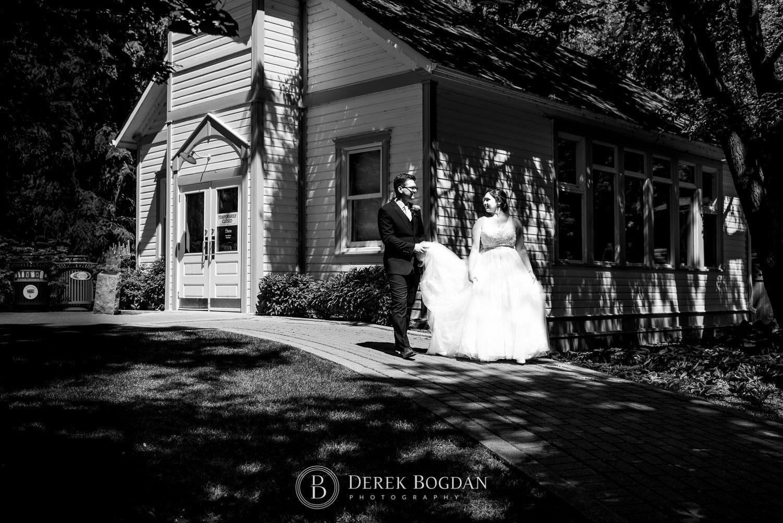 Bride and groom walking portrait Assiniboine Park