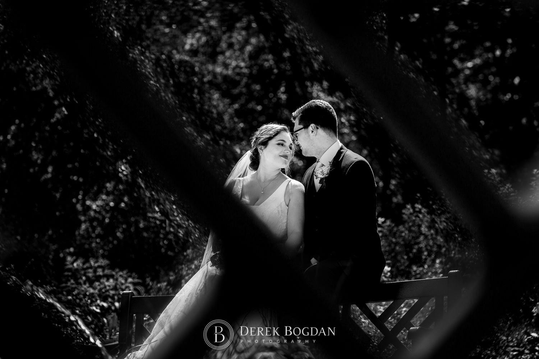 Bride and groom portrait bench photo Assiniboine Park