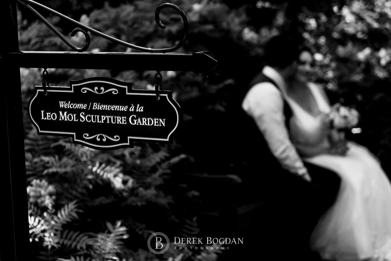 Bride and groom portrait Leo Mol Sculpture Garden