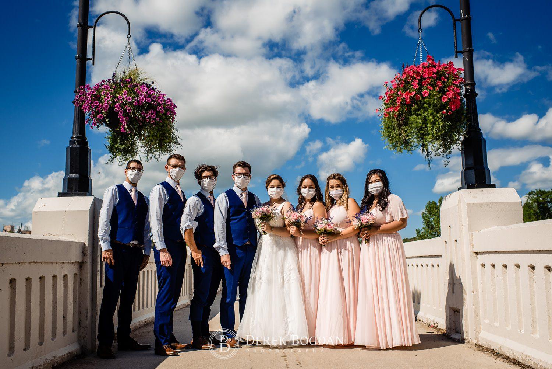 Bride, groom and wedding party portrait bridge Assiniboine Park