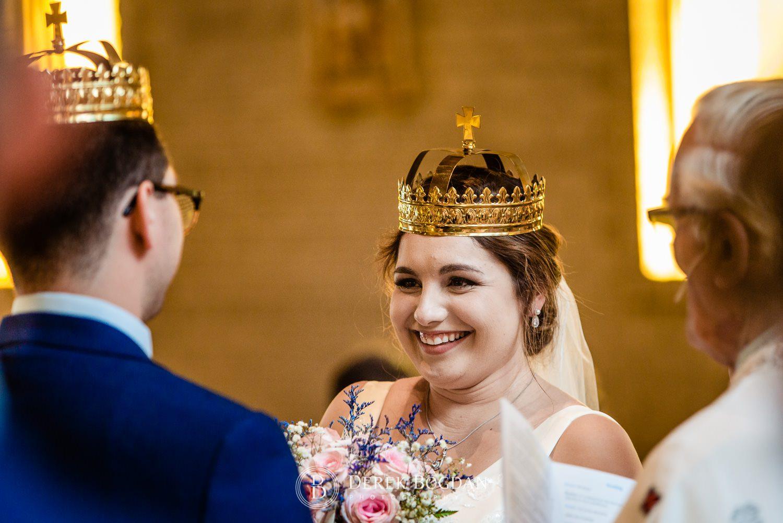 Ukrainian church wedding catholic ceremony details crowning bride smiles Ukrainian church wedding