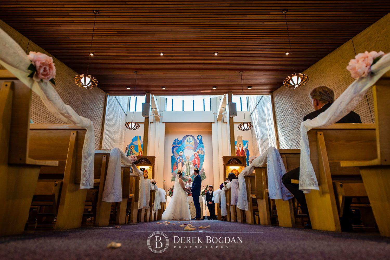 Ukrainian church wedding catholic ceremony bride and groom standing Ukrainian church wedding