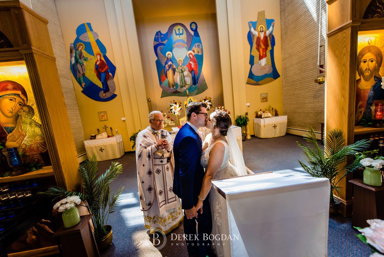 Ukrainian church wedding catholic ceremony bride groom first kiss Ukrainian church wedding