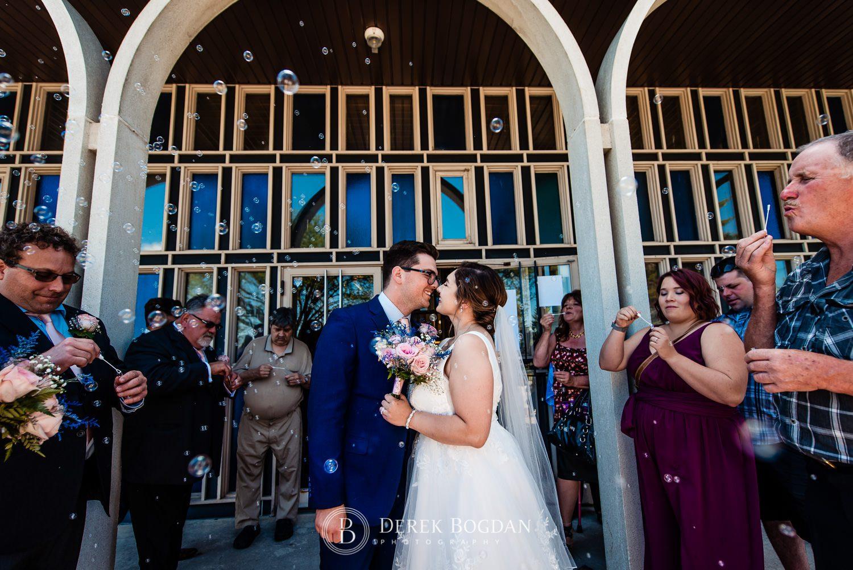 Ukrainian church wedding in front of church bubbles Ukrainian church wedding