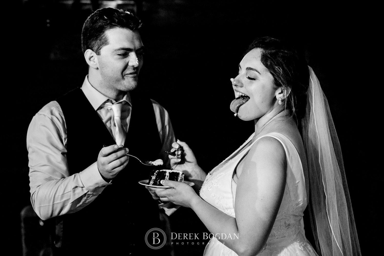 bride and groom cake cutting fun Ukrainian church wedding