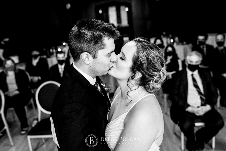 Manitoba Club Wedding Ceremony bride groom first kiss