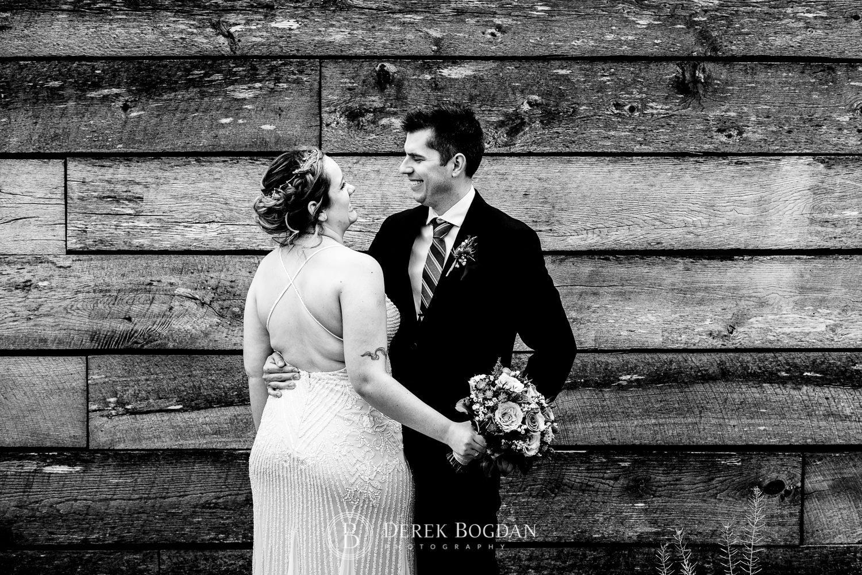 Manitoba Club Wedding post ceremony outdoor portrait bride groom smiles by wall