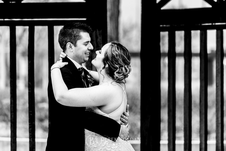 Manitoba Club Wedding post ceremony outdoor portrait bride groom hugging