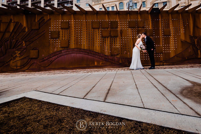 Manitoba Club Wedding post ceremony outdoor portrait kiss
